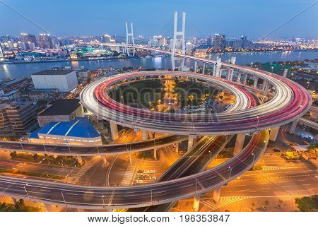 Shanghai overpass at night in China .