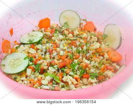 A delicious bowl of conch ceviche freshly garnished with cucumbers is a Belizean favorite.