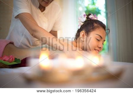 Masseur doing massage spa with treatment on Asian woman body in the Thai spa lifestyle so relax and luxury. Healthy Concept