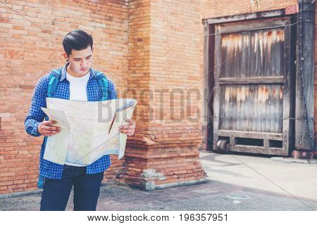 Travel Man Trendy Look Searching Direction On Location Map While Traveling In City During Vacation