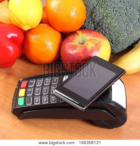 Mobile Phone With Nfc Technology On Payment Terminal And Fruits With Vegetables, Cashless Paying For