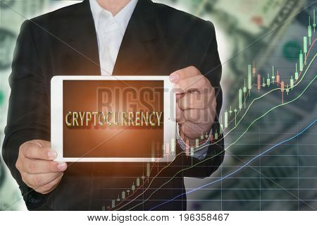 Cryptocurrency Concept : Business man showing tabet with cryptocurrency text and rising price graph on money background.
