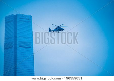 high section of a helicopter hovering over shanghai skyscrapers.