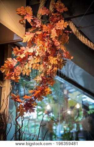 a decoration item is maple leaf with branch