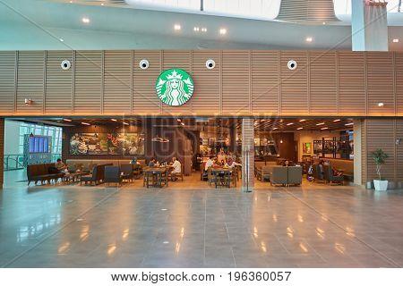 KUALA LUMPUR, MALAYSIA - CIRCA MAY, 2014: Starbucks coffee shop at Kuala Lumpur International Airport low-cost carrier terminal.