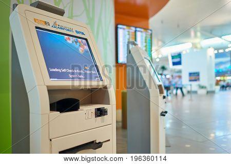 KUALA LUMPUR, MALAYSIA - CIRCA MAY, 2014: self check-in kiost at low-cost carrier terminal at Kuala Lumpur International Airport.