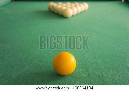Russian Billiards - Large White Balls With An Orange Cue And A Wooden Cue On A Large Table With Gree