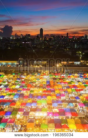 Aerial view city multiple colour weekend flea market with after sunset sky background
