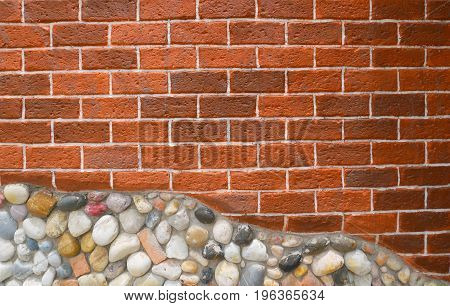 Red brick and stone wall with cement decorative with stone it has the distinction of stone color. Can be use for background