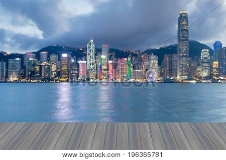Opening wooden floor Hong Kong central business downtown blurred bokeh light abstract background