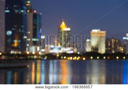 Night twilight blurred bokeh light office building abstract background