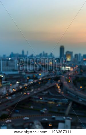 Aerial view Blurred bokeh city light and highway interchanged skyline abstract background