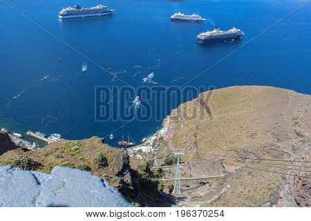 Panoramic view from city of Thira to the caldera and the cableway on Thira Island. Santorini, Greece.