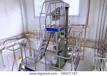 Industrial dairy production. View on the equipment on the milk factory.