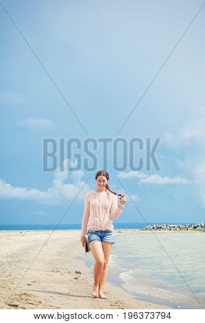 Woman  Walking Along The Sea