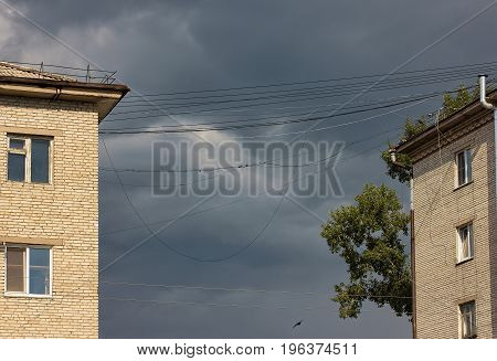 Dangerously overhanging electrical wires before the storm.