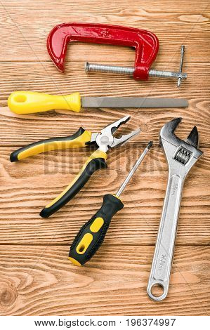 Set of hand tools on a wooden background