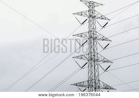 High voltage tower with not clear sky background