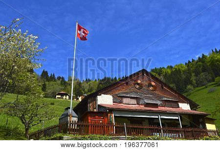 Chalet with Swiss flag Les Avants Vaud Switzerland