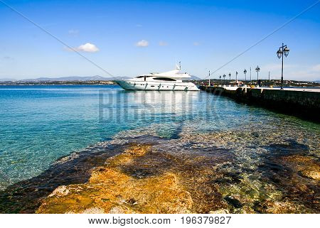 Luxury motor boat and the pier in the port of Spetses island Greece