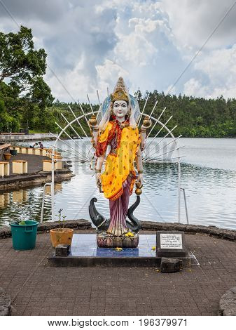 Grand Bassin Mauritius - December 26 2017: Statue of an indian (hindu buddhist) divinity in a hindu temple (Grand Basin) in Mauritius.