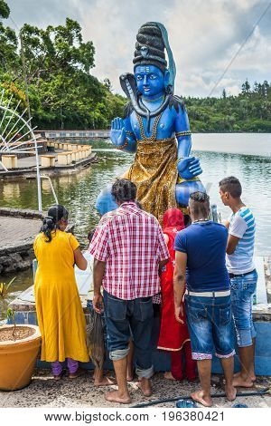 Grand Bassin Mauritius - December 26 2017: Group of people praying at Grand Bassin temple on December 29 2014 in Mauritius. It is considered the most sacred Hindu place in Mauritius.