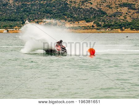 Man on Jet Ski turns fast on the water speed games