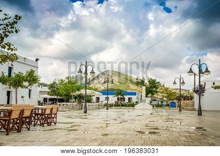 Rainy day and heavy sky over the town square of Skyros island. Sporades islands . Greece