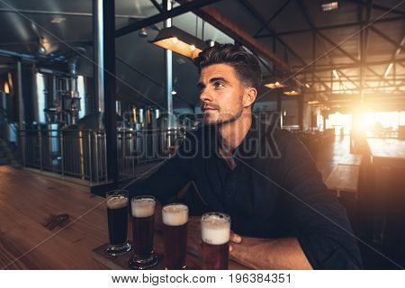 Man Tasting Different Types Of Beer At The Brewery