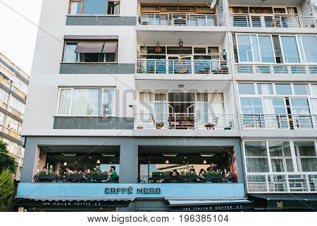 Istanbul, June 14, 2017: A popular Italian coffee called Nero Cafe on the second floor of an apartment building in the Asian part of Istanbul. Communication of people, meeting friends.