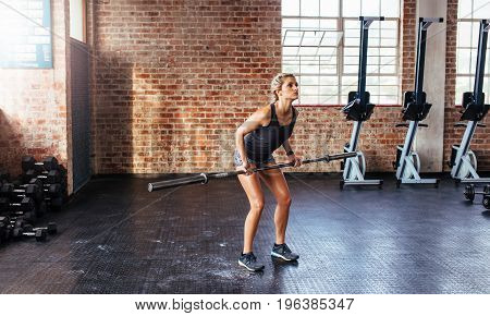 Sportswoman Exercising In Gymnasium.