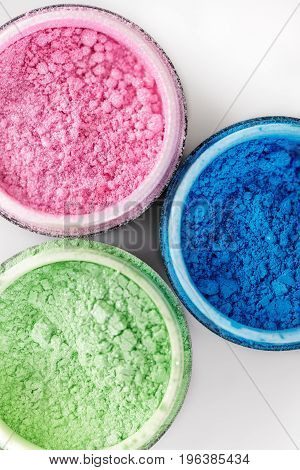 Multicolored professional powder eye-shadows on the white background