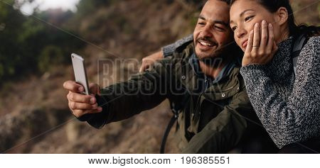 Loving Young Couple On Hike Taking A Selfie