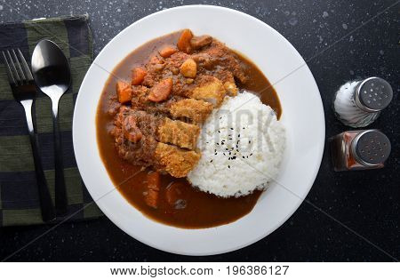 Rice With Deep Fried Pork And Curry .