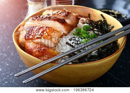 Rice with teriyaki chicken grill or teriyaki don in Japanese style set and ready to eat in studio lighting
