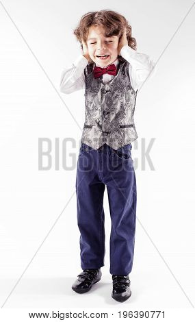 Cute Curly Boy In A Silver Waistcoat Is Facing The Camera With His Eyes Closed And Ears And Mouth Op
