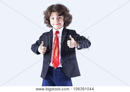 Cute Curly-haired Boy In A Jacket Unbuttoned Showing Hand Gestures