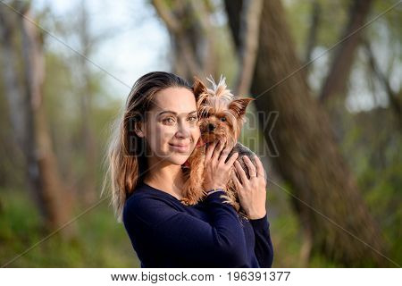 Pretty Young Girl Holds Her Best Friend Little Pet Puppy Of Yorkshire Terrier Breed In Her Arms And