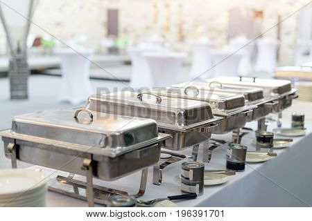 Buffet heated trays standing in line ready for service. Outdoors buffet restaurant, the hotel restaurant
