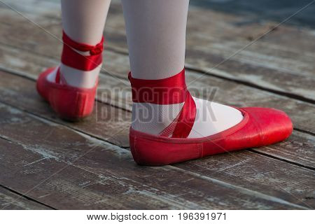Red ballet shoes with white socks in ballerina.