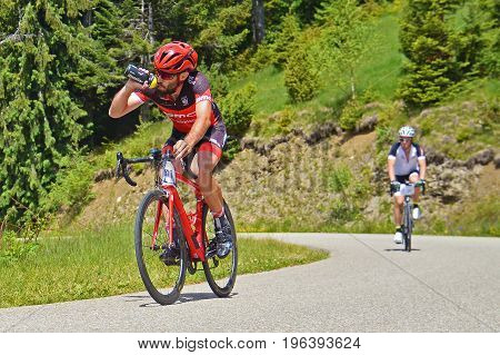 Muntele Mic Romania - June 10: Two athletes competing in the Muntele Mic Vertical Race road cycling cometition. Shot taken on June 10th 2017