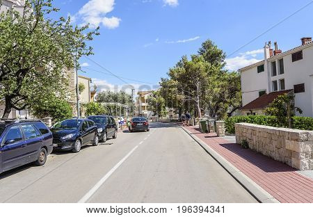MAKARSKA RIVIERA, CROATIA - 3 JULY, 2017: Streets of the resort town of Makarska summer day. Makarska, one of the most popular destinations for beach holidays for tourists in Croatia.