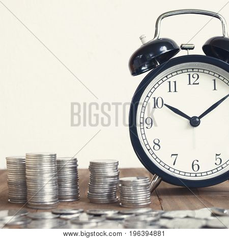 Stack Of Coins With Black Fashioned Alarm Clock For Display Planning Money Financial And Business Accounting Concept Time Is Money Concept Time To Work At Make Money Vintage Color Tone