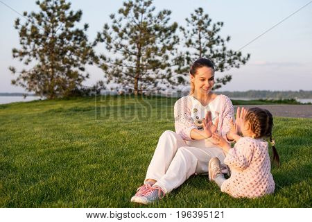 Lifestyle Portrait Mom And Daughter In Happines At The Outside In The Meadow