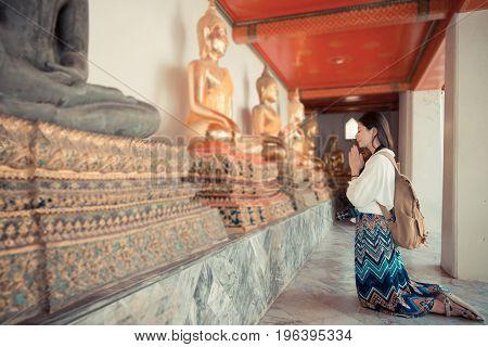 Smiling Female Tourist Kneel Down In Bangkok