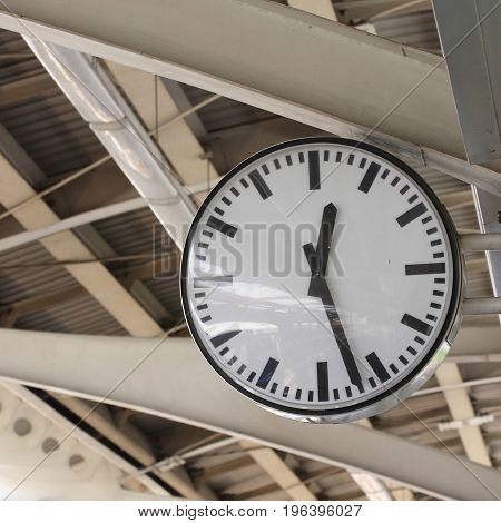 Black and white clock in railway station.