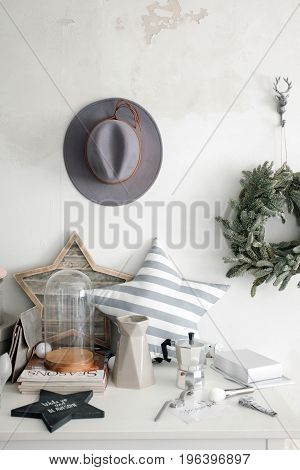 Elements of the Scandinavian interior and a hat on the wall