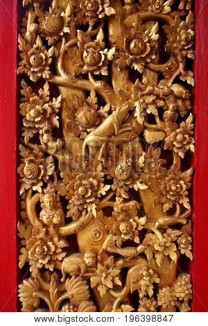 Traditional woodcraft, ancient art in thai temple.