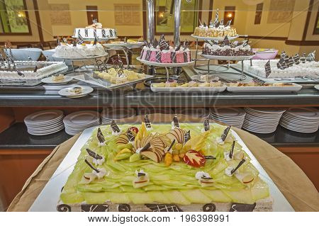 Selection Of Desserts On Display At A Restaurant Buffet