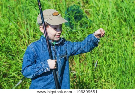Boy Fishing In The Summer